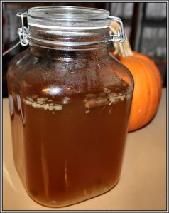 Water kefir in 3-liter Fido - Day 2 - raisins and grains bubble up and back down