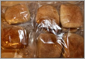 A dozen sandwich rolls double bagged and ready to go in the freezer