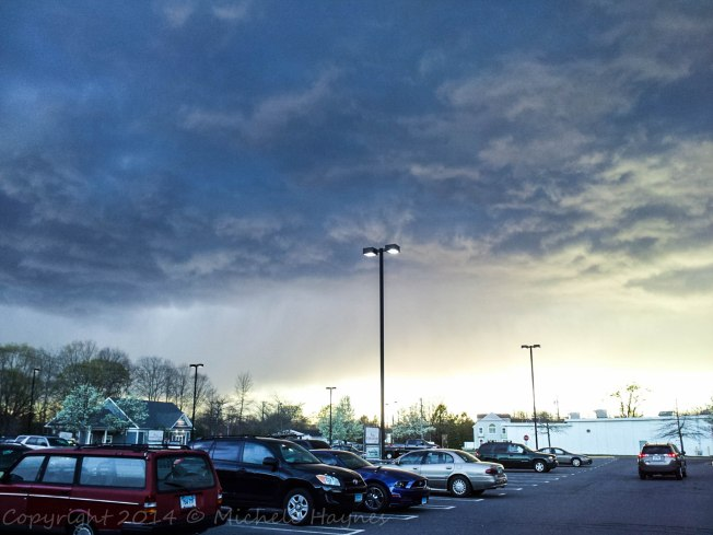Spring storm looming outside grocery store. Tiny hail assaulted the car on the way home. Sunday, May 4, 2014.